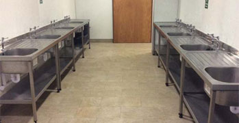 Dishwashing Area and Fridge Freezers
